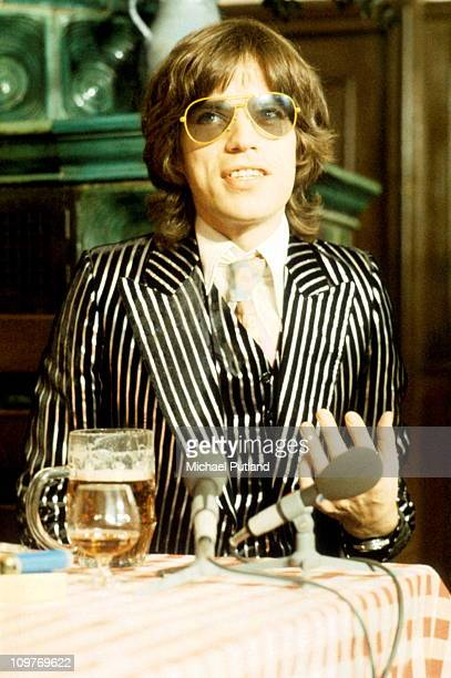 Singer Mick Jagger of The Rolling Stones wearing a striped suit in 1973.