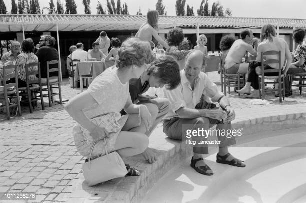 Singer Mick Jagger of The Rolling Stones with his parents Eva and Joe in St Tropez France for Mick's wedding to Bianca De Macias 12th May 1971