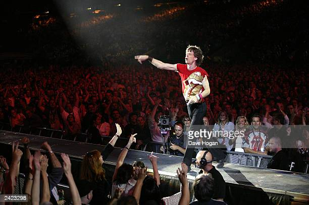 Singer Mick Jagger performs with the Rolling Stones during the Licks World Tour 2003 August 24 2003 in Twickenham England