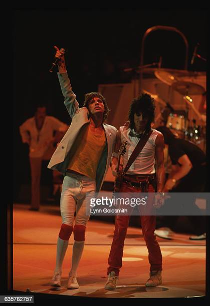 Singer Mick Jagger stands on stage with guitarist Ron Wood during a Rolling Stones concert
