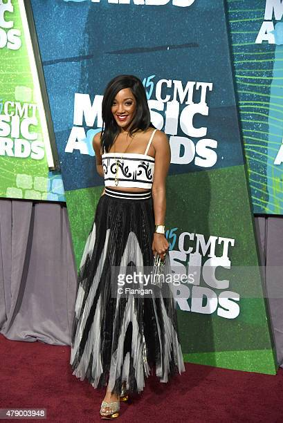 Singer Mickey Guyton attends the 2015 CMT Music awards at the Bridgestone Arena on June 10 2015 in Nashville Tennessee
