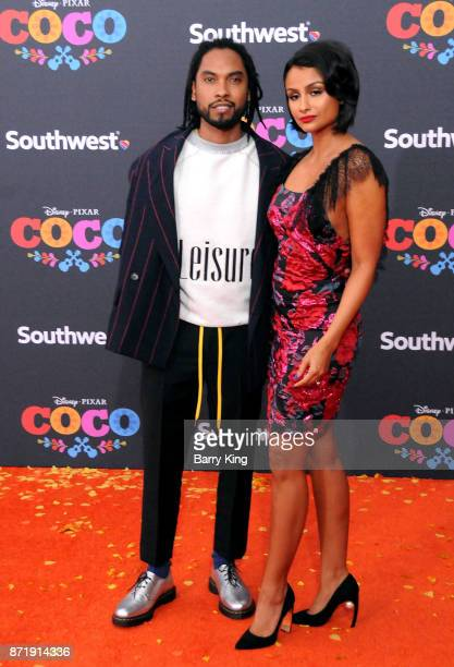 Singer Miguel and guest attend the US Premiere of Disney Pixar's 'Coco' at El Capitan Theatre on November 8 2017 in Los Angeles California