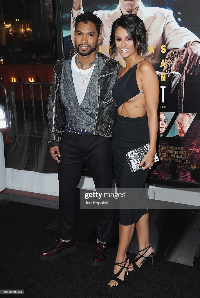 Singer Miguel and Nazanin Mandi arrive at the Premiere of 'Live By Night' at TCL Chinese Theatre on January 9, 2017 in Hollywood, California.