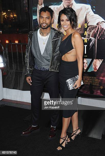 Singer Miguel and Nazanin Mandi arrive at the Premiere of Live By Night at TCL Chinese Theatre on January 9 2017 in Hollywood California