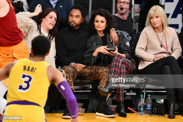 Singer Miguel and Nazanin Mandi attend a basketball game between the Los Angeles Lakers and the Indiana Pacers at Staples Center on November 29 2018...