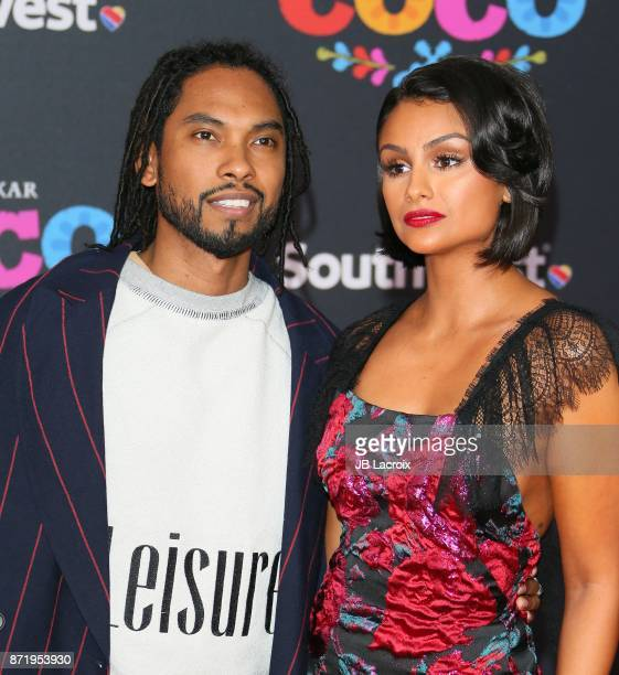 Singer Miguel and Nazanin Mandi attend the premiere of Disney Pixar's 'Coco' on November 8 2017 in Los Angeles California