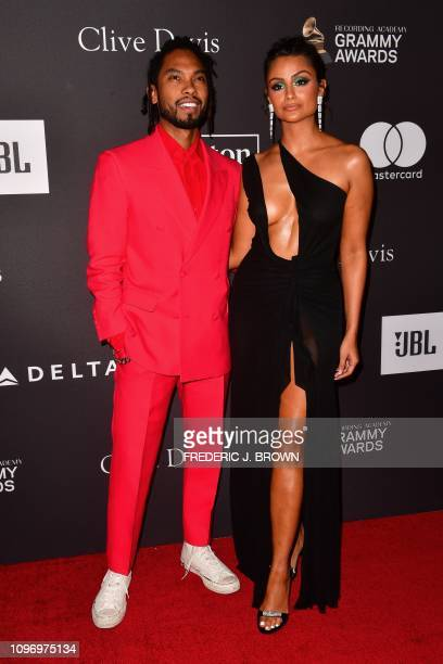 US singer Miguel and US actress Nazanin Mandi arrive for the traditional Clive Davis party on the eve of the 61th Annual Grammy Awards at the Beverly...