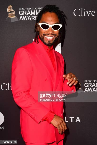 US singer Miguel arrives for the traditional Clive Davis party on the eve of the 61th Annual Grammy Awards at the Beverly Hilton hotel in Beverly...