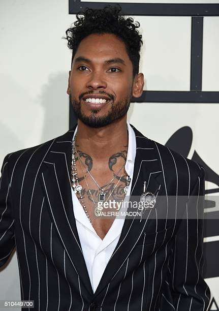 Singer Miguel arrives on the red carpet for the 58th Annual Grammy music Awards in Los Angeles February 15 2016 AFP PHOTO/ VALERIE MACON / AFP /...