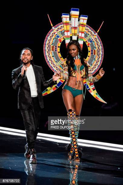 US singer Miguel performs next to British model Leomie Anderson during the 2017 Victoria's Secret Fashion Show in Shanghai on November 20 2017 / AFP...