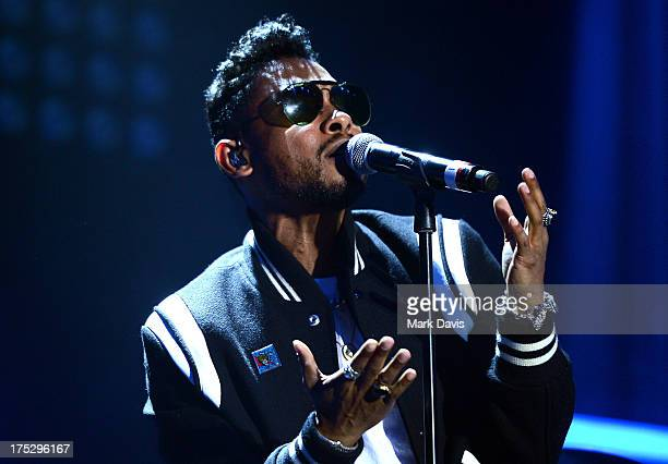 Singer Miguel performs onstage during Bud Light Music First 50/50/1 featuring Miguel at Hollywood Palladium on August 1 2013 in Hollywood California