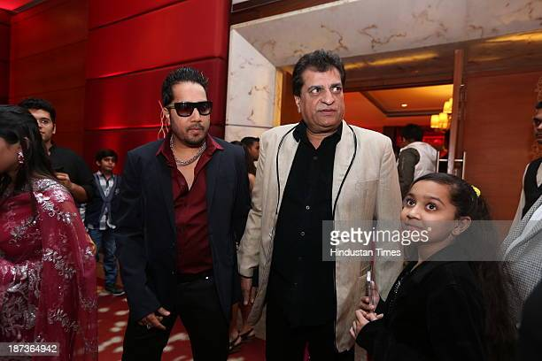 Singer Mika with Prem Bhatia during prewedding party of singer Daler Mehndi's daughter Ajit Kaur with Navraj Singh son of singer Hans Raj Hans on...