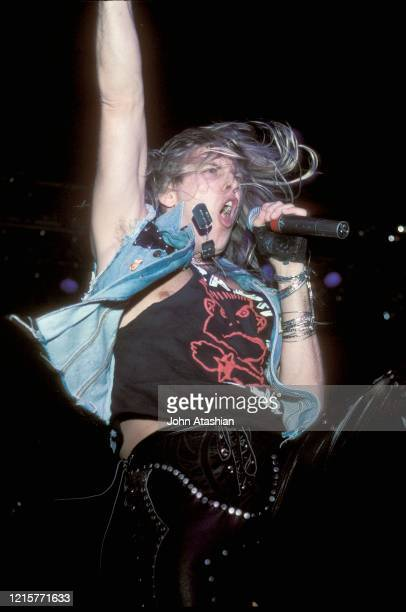 Singer Mike Pont is shown performing on stage during a live concert appearance with Danger Danger on November 27 1990