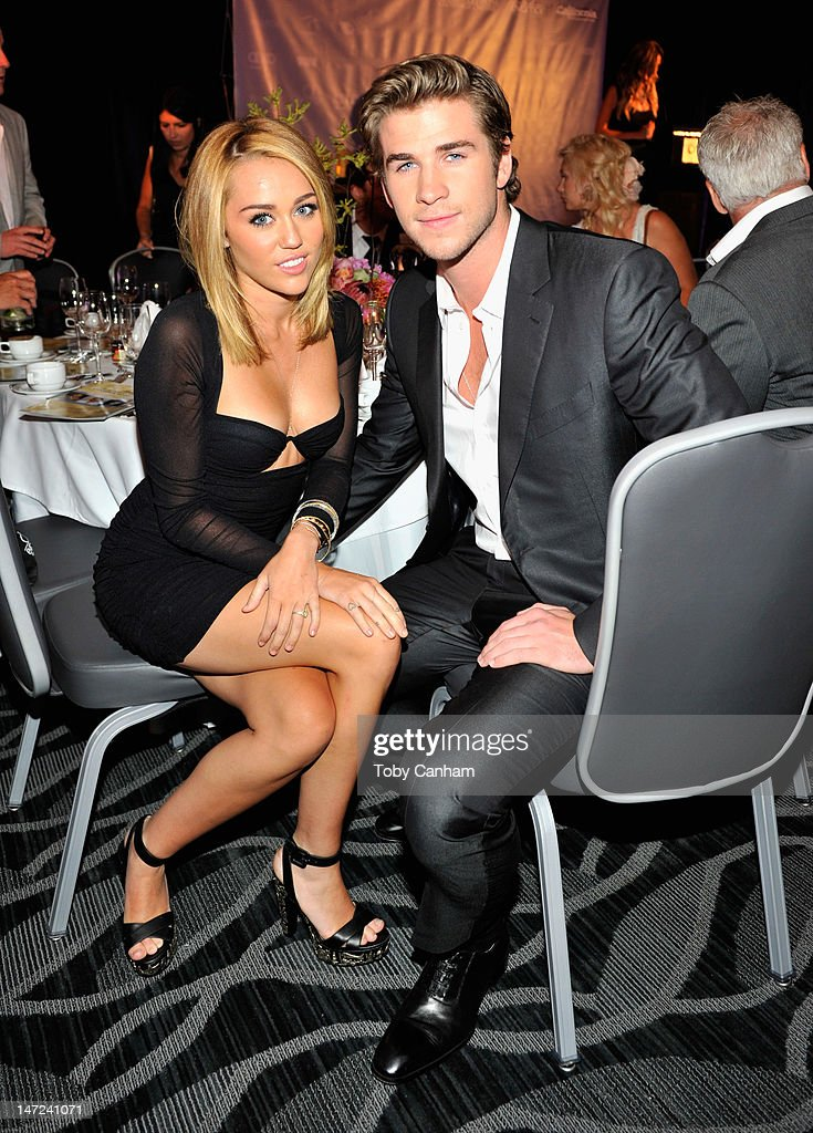 Singer Miley Cyrus and actor Liam Hemsworth attend Australians In Film Awards & Benefit Dinner at InterContinental Hotel on June 27, 2012 in Century City, California.