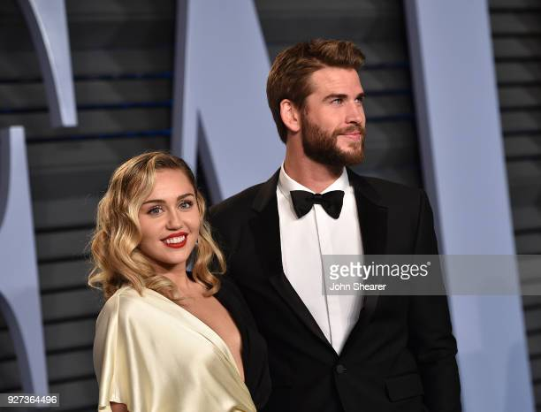 Singer Miley Cyrus and actor Liam Hemsworth attend the 2018 Vanity Fair Oscar Party hosted by Radhika Jones at Wallis Annenberg Center for the...