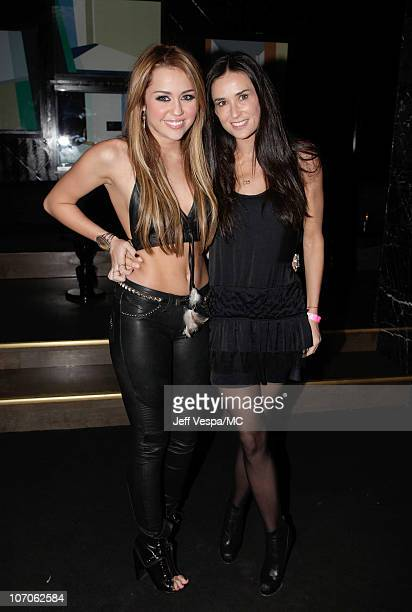 Singer Miley Cyrus and actress Demi Moore attend Miley Cyrus' 18th Birthday Party at Trousdale on November 21 2010 in West Hollywood California