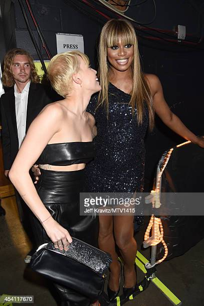 Singer Miley Cyrus and actress Laverne Cox attend the 2014 MTV Video Music Awards at The Forum on August 24 2014 in Inglewood California
