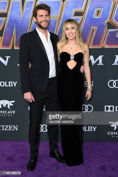 US singer Miley Cyrus and Australian actor Liam Hemsworth arrive for the World premiere of Marvel Studios' Avengers Endgame at the Los Angeles...