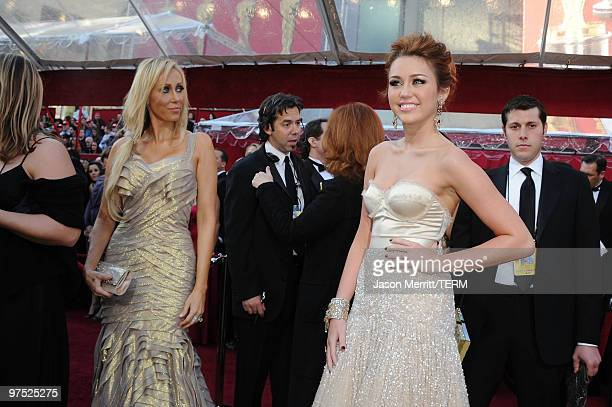 Singer Miley Cyrus and her mother Tish Cyrus arrive at the 82nd Annual Academy Awards held at Kodak Theatre on March 7, 2010 in Hollywood, California.
