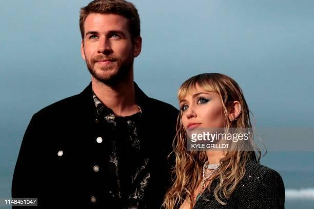 US singer Miley Cyrus and husband Australian actor Liam Hemsworth arrive for the Saint Laurent Men's SpringSummer 2020 runway show in Malibu...