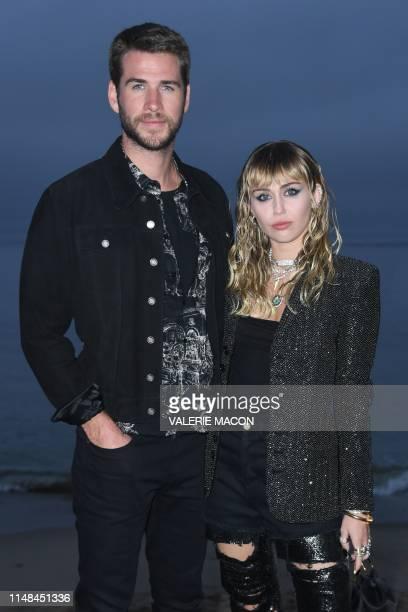 US singer Miley Cyrus and husband Australisn actor Liam Hemsworth arrive for the Saint Laurent Men's SpringSummer 2020 runway show in Malibu...