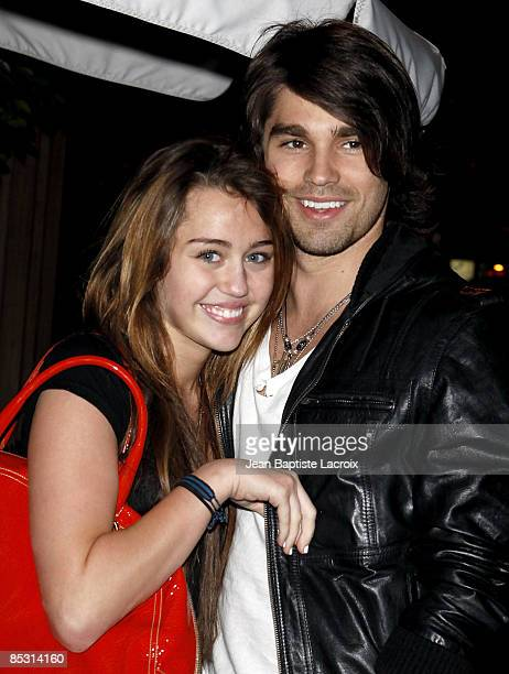 Singer Miley Cyrus and model Justin Gaston visit Nubu March 9 2009 in West Hollywood California