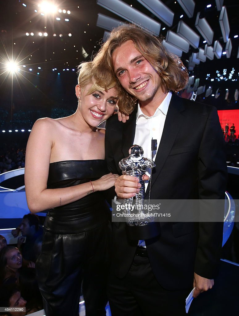 Singer Miley Cyrus (L) and My Friend's Place representative Jesse Helt attend the 2014 MTV Video Music Awards at The Forum on August 24, 2014 in Inglewood, California.