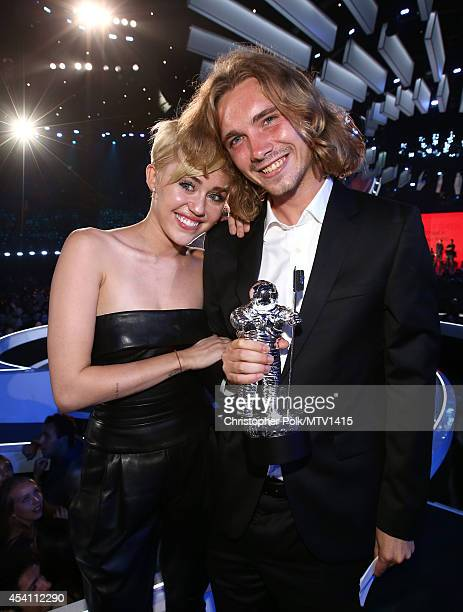 Singer Miley Cyrus and My Friend's Place representative Jesse Helt attend the 2014 MTV Video Music Awards at The Forum on August 24 2014 in Inglewood...