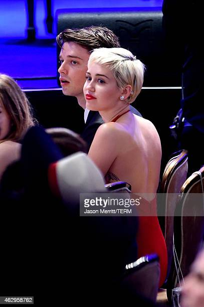 Singer Miley Cyrus and Patrick Schwarzenegger attend the PreGRAMMY Gala and Salute to Industry Icons honoring Martin Bandier at The Beverly Hilton...