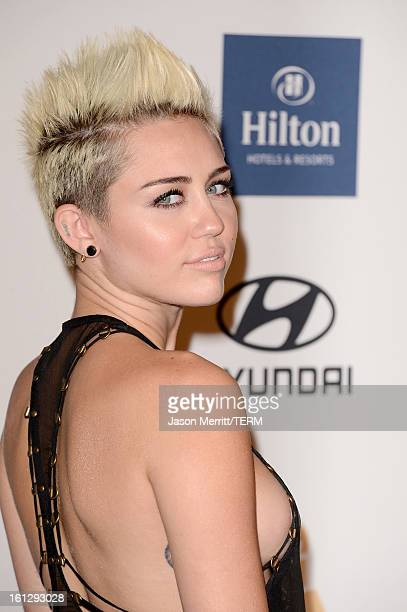 Singer Miley Cyrus arrives at Clive Davis The Recording Academy's 2013 PreGRAMMY Gala and Salute to Industry Icons honoring Antonio LA Reid at The...