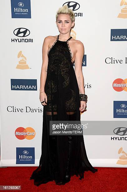 Singer Miley Cyrus arrives at Clive Davis The Recording Academy's 2013 PreGRAMMY Gala and Salute to Industry Icons honoring Antonio 'LA' Reid at The...