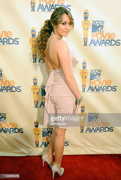 Singer Miley Cyrus arrives at the 2009 MTV Movie Awards held at the Gibson Amphitheatre on May 31 2009 in Universal City California