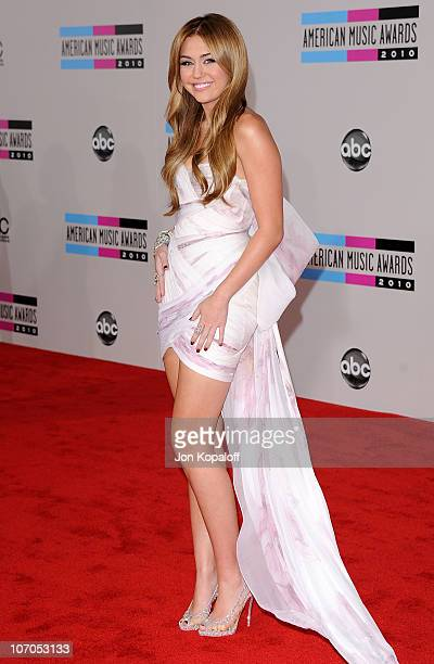 Singer Miley Cyrus arrives at the 2010 American Music Awards held at Nokia Theatre LA Live on November 21 2010 in Los Angeles California