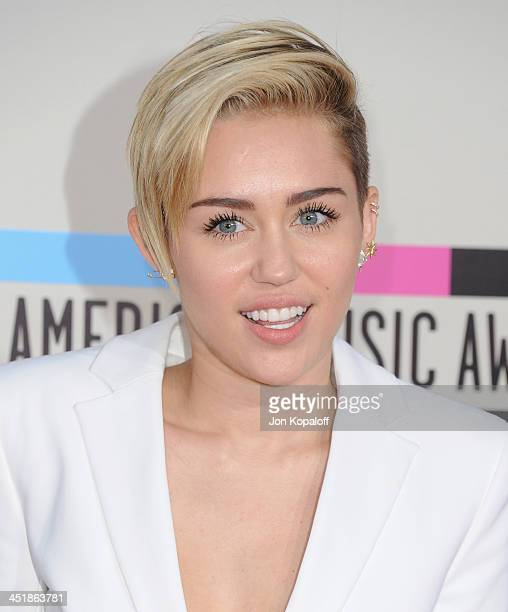 Singer Miley Cyrus arrives at the 2013 American Music Awards at Nokia Theatre LA Live on November 24 2013 in Los Angeles California