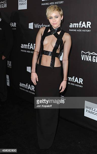 Singer Miley Cyrus arrives at the 2014 amfAR LA Inspiration Gala at Milk Studios on October 29 2014 in Hollywood California