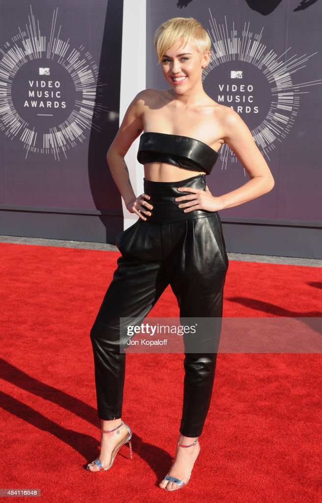 Singer Miley Cyrus arrives at the 2014 MTV Video Music Awards at The Forum on August 24, 2014 in Inglewood, California.