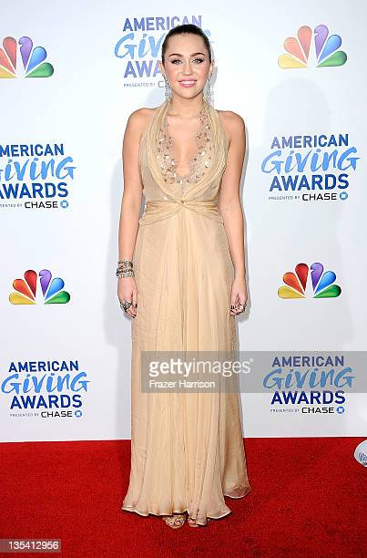 Singer Miley Cyrus arrives at the American Giving Awards Presented By Chase at Dorothy Chandler Pavilion on December 9, 2011 in Los Angeles,...