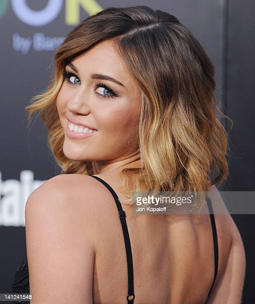 Singer Miley Cyrus arrives at the Los Angeles Premiere The Hunger Games at Nokia Theatre LA Live on March 12 2012 in Los Angeles California