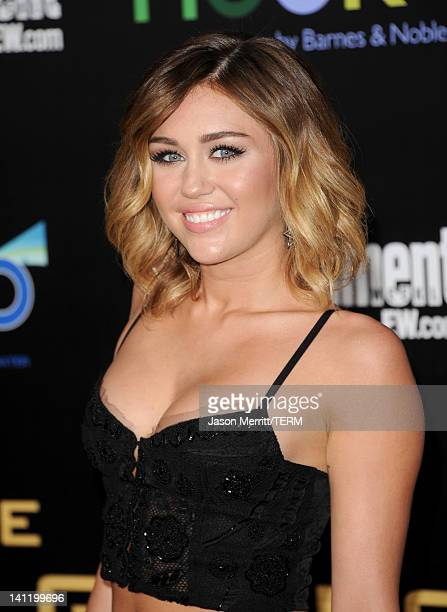 """Singer Miley Cyrus arrives at the premiere of Lionsgate's """"The Hunger Games"""" at Nokia Theatre L.A. Live on March 12, 2012 in Los Angeles, California."""