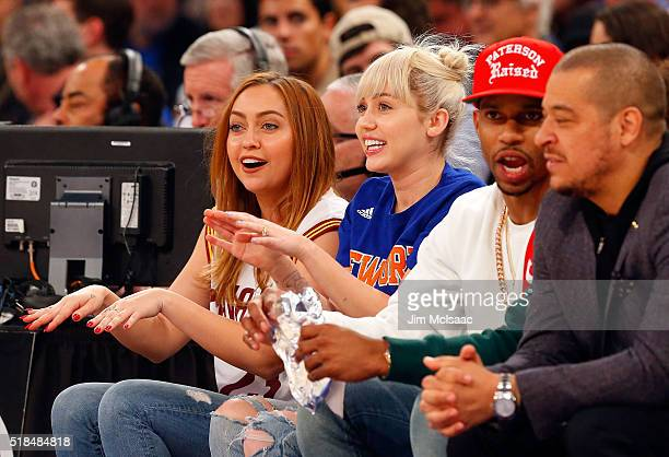 Singer Miley Cyrus attends a game between the New York Knicks and the Cleveland Cavaliers at Madison Square Garden on March 26 2016 in New York City...