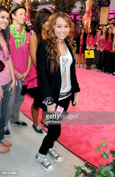Singer Miley Cyrus attends A MileySized Surprise presented by FNMTV at Arnold O Beckman High School on December 31 2008 in Irvine California