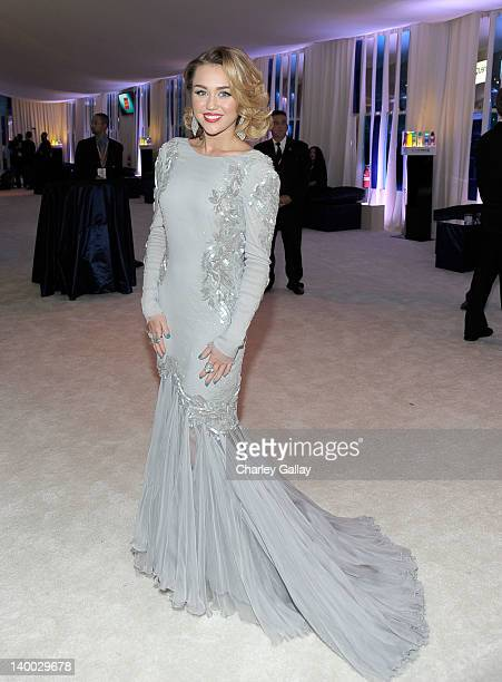 Singer Miley Cyrus attends Godiva at 20th Annual Elton John AIDS Foundation Academy Awards Viewing Party at The City of West Hollywood Park on...