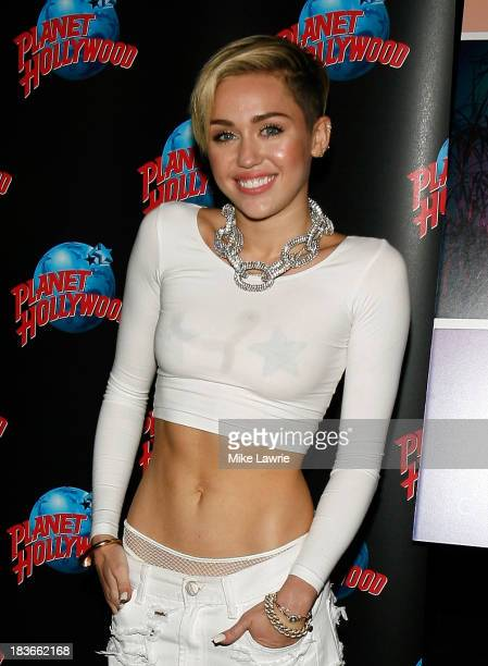 Singer Miley Cyrus attends her Bangerz Record Release Signing at Planet Hollywood Times Square on October 8 2013 in New York City