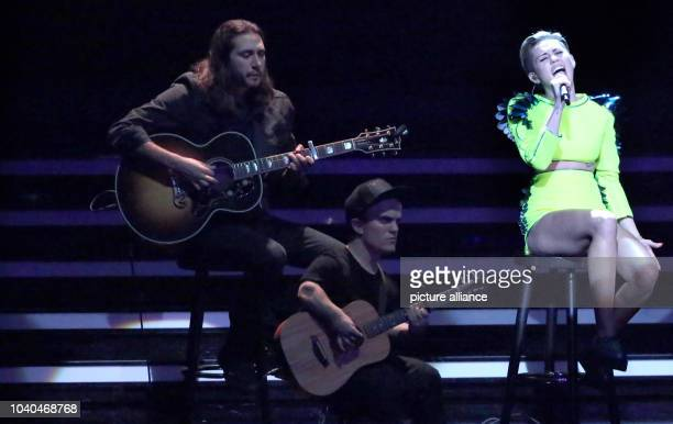 US singer Miley Cyrus performes at the 65th Bambi award ceremony at the Stage Theater in Berlin Germany 14 November 2013 The Burda media prize will...