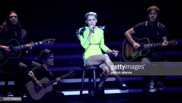 US singer Miley Cyrus performes for the 65th Bambi award ceremony at the Stage Theater in Berlin Germany 14 November 2013 The Burda media prize will...