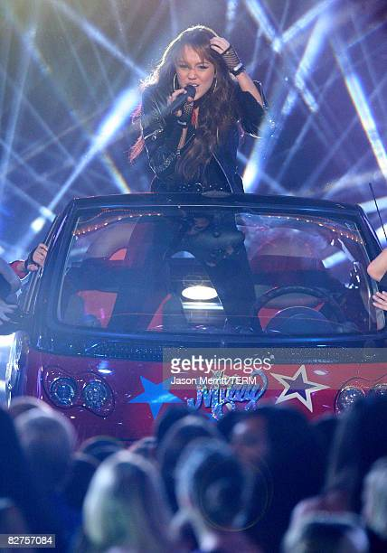 Singer Miley Cyrus performs at Nickelodeon's 2008 Kids' Choice Awards on March 29 2008 at the Pauley Pavilion in Los Angeles California