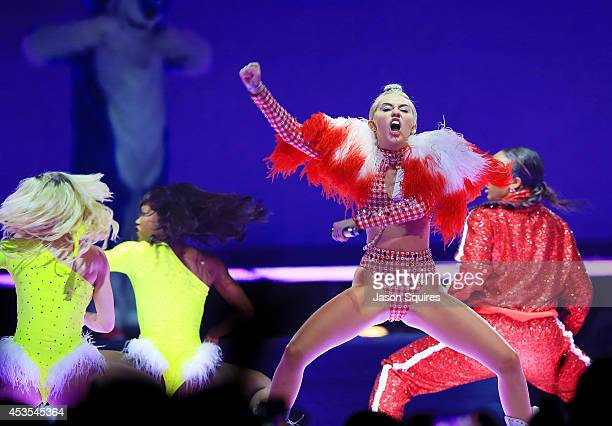 Singer Miley Cyrus performs at Sprint Center on August 12 2014 in Kansas City Missouri
