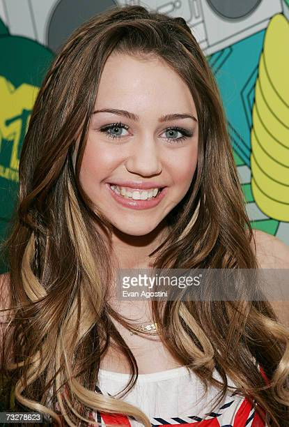 Singer Miley Cyrus poses backstage after appearing on MTV's Total Request Live on February 9 2007 at MTV Studios in New York City