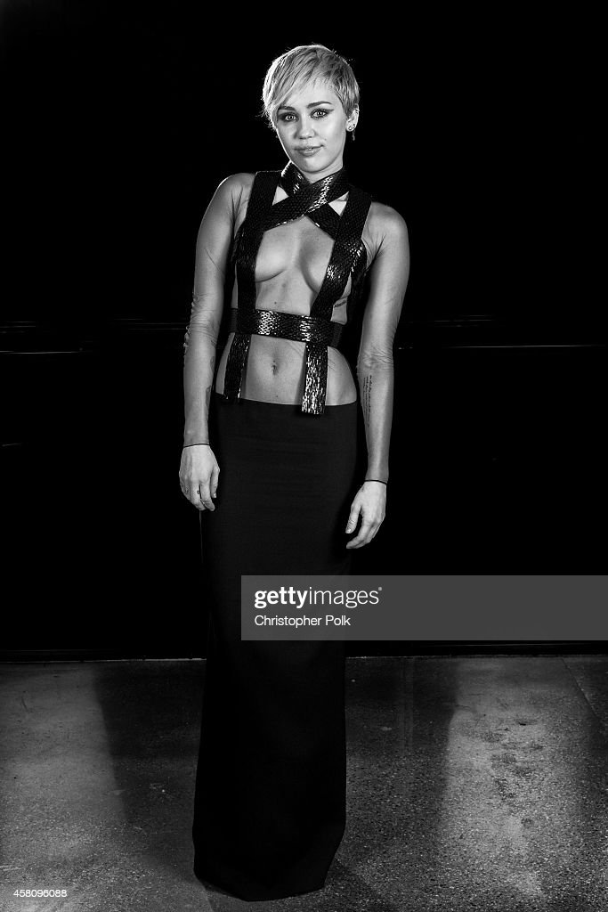 Singer Miley Cyrus poses for photos backstage at Milk Studios on October 29, 2014 in Hollywood, California.