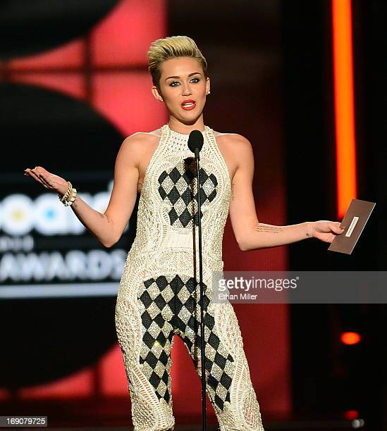 Singer Miley Cyrus speaks onstage during the 2013 Billboard Music Awards at the MGM Grand Garden Arena on May 19 2013 in Las Vegas Nevada